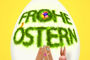 Osterhase bemalt ein Ei